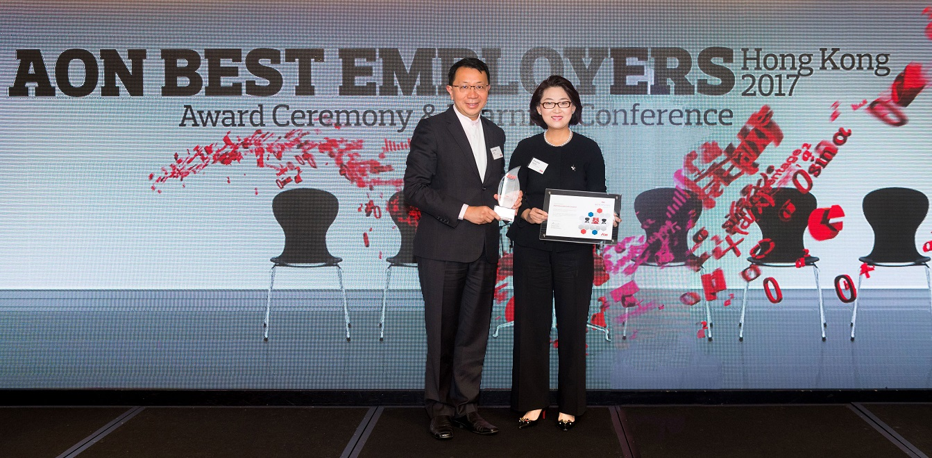 "Mr. Jim Jan Zen, Chief Agency Officer, Agency Distribution of AIA Hong Kong and Macau (left) and  Ms. Pauline Teoh, Chief Partnership Distribution Officer of AIA Hong Kong and Macau (right)  receive the ""Best Employer Hong Kong"" award on behalf of the Company.  AIA is the first insurer ever in Hong Kong to be honoured with this accolade for two consecutive years. The Company takes pride in offering its employees a healthy and happy workplace full of career opportunities."